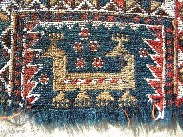 Two fragments, possibly a pair of horse cover arms, 63 x 38 cms each, extra-weft wrapping on blue warps and red warps, cotton highlighting; Baku horse covers are known to have sections  ...