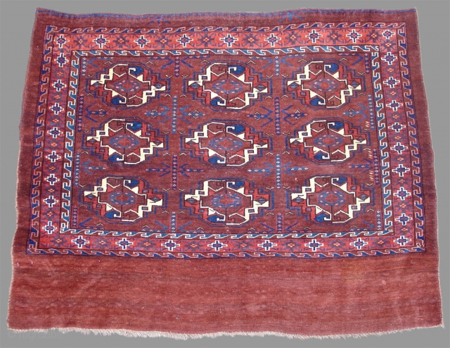 Yomut Chuval Turkmenistan , 19th C (3rd Q) The spacing of this finely woven Turkmen chuval with a blank elem is quite fine as are the narrow and elegantly drawn chemcheh minor guls. The  ...