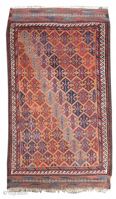 This vividly colored Baluch rug combines two very characteristically Baluchi themes that are very seldom seen in the same weaving: a camel ground with an all-over pattern of double-anchor ornament. Derived from  ...