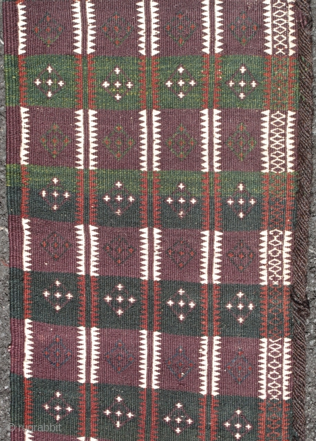 Baluch Flatwoven Trapping, southwestern Pakistan, early 20th century. A minority of Baluch weavings can actually be attributed to Balochistan proper. This long trapping woven finely with floating weft technique is expertly dyed with  ...