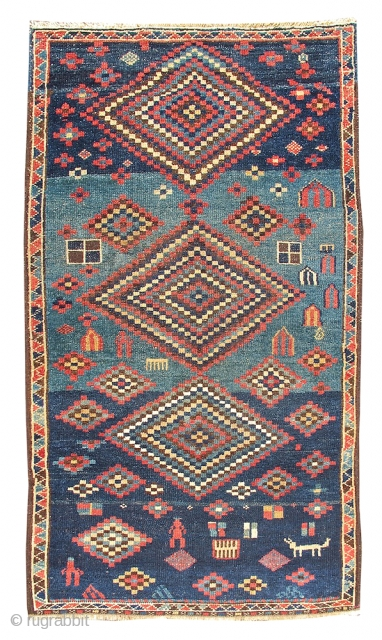 This happy rug from Northwest Persia exemplifies the spirit of great Kurdish village weaving. Multi-colored, eye-dazzling diamonds are drawn against a blue field with a playful use of モabrashヤ or modulated hues.  ...