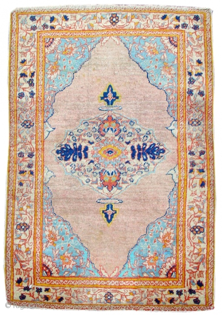This elegant antique Tabriz mat faithfully reproduces in miniaturized format a formal nineteenth century Persian medallion design with fine detailing of floral elements including exceptionally drawn quartered blossoms in the corner pieces.  ...