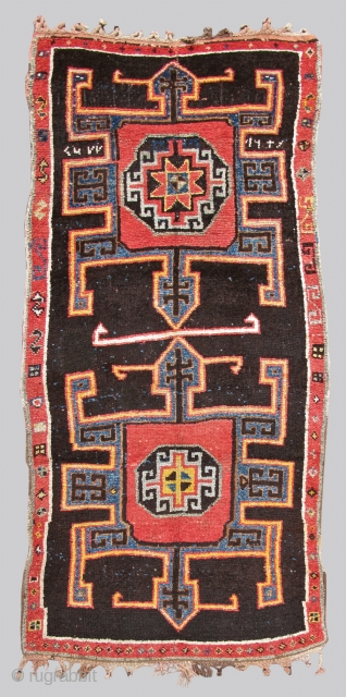 This bold village rug employs soft wool and a rustic weave. Representing design features from the related border areas of eastern Anatolia, the Caucasus, and northwest Persia, this piece was most probably  ...