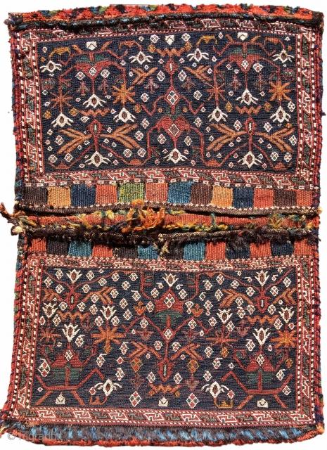 "Bakhtiari sumak khorjin size= 1'11"" x 2'8"" , rug# 19099  Luri Bakhtiari bags are known for their distinctive integration of sumak and other flatweave techniques. This Luri Bakhtiari 'khorjin' double saddle bag makes  ..."