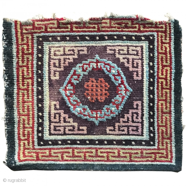 """Tibetan seating square with an aubergine ground. 2'0""""x2'0"""".  https://www.peterpap.com/product/tibetan-mat-6/"""