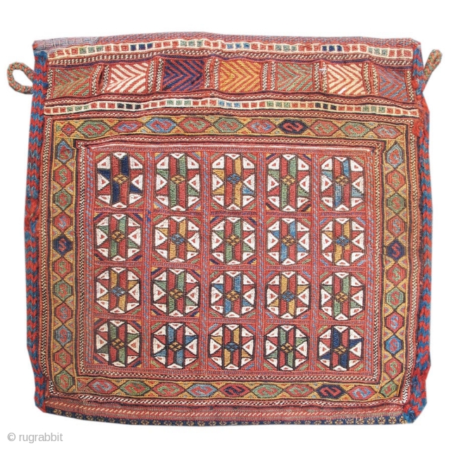 This exceptional Afshar sumak bag draws colorful diagonal rows of eight-pointed stars within octagons set against a rose madder ground. With crisp drawing and superb contrast of color, the effect is reminiscent  ...