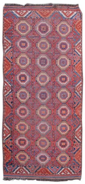 "Central Asian Bashir type Middle Amu Darya area Turkmen rug with geometric design and curled-leaf border. Great color and wool. size= 3'10 x 8'6"".Inv# 17868"
