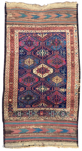 Baluch rug with a tile design and complete kilim ends. Great color with both cochineal and some fuchsine, both probably seen as luxury import dyes when this piece was woven in the  ...