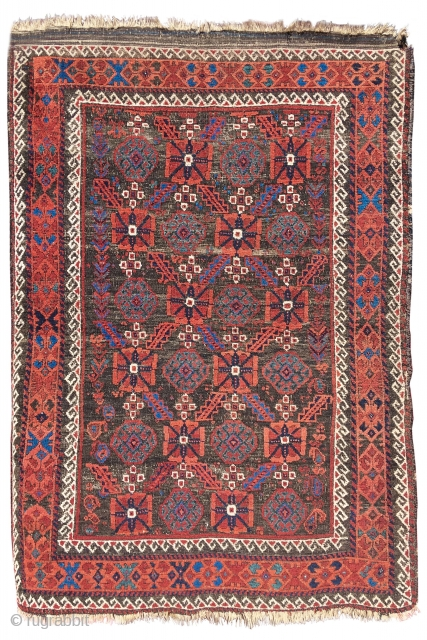Baluch rug with a minakhani field. Arab Baluch type, Northest Persian. Rare design for this type. Glistening wool and natural color.