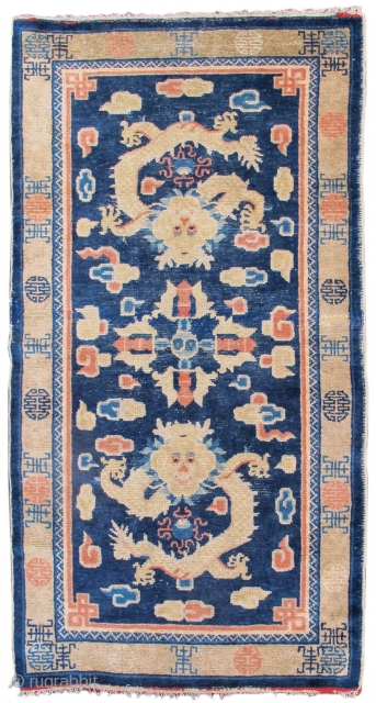 """Ningxia / Ning Hsia rug with two dragons and a vajra in the field. """"Shu"""" sign border. Late 19th century. http://www.peterpap.com/rugDetail.cfm?rugID=17930"""