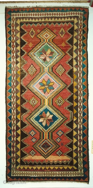 Chahar Mahal Gabbeh ca. 1900.  Natural colors. Pristine condition. 80 X 203 cm, or 38 X 97 in.  Nice tribal piece - good graphics.