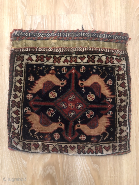 A very old and nice Qashghyi bag face with Birds.size:32x32 cm,its over 100 years.over all good condition except one small repair on weave and a very small rewove.it has a very soft  ...