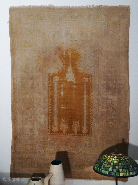 A rare antique Panderma/Bandirma saffron silk prayer rug with 173/120 cm in used condition.