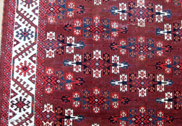 "Yomud Main Carpet, 5'5"" x 8'8"", 2nd half 19th C.  This lovely old Kepse gul main carpet represents a wonderful example of Yomud tribal weaving. The piled elems are unusual, the  ..."