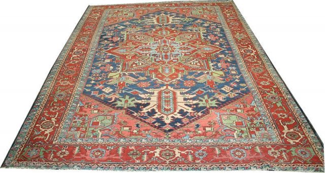 "A fabulous decorative Persian Serapi from 1910. It is in very good condition for its age. low even pile from top to bottom, no foundation threads are visible. It measures 8'-5"" x  ..."