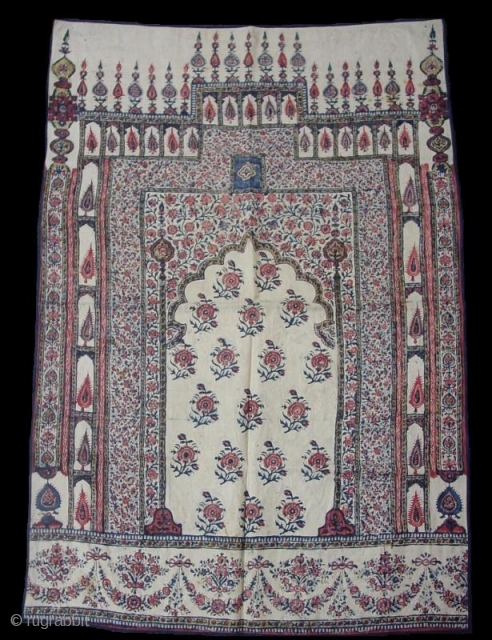 Indian printed and painted cotton from first half of 19th century. Hand spun and woven cotton and natural dyes.   Backside is imported English chintz.