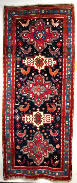 kazak, Karabach, Lampa, 290 x 117 Cm. Dated - 1308 = 1891. Beautiful cochenille red. Great high pile - 1 cm.  The wool looks splendid, the only mark of it's old  ...