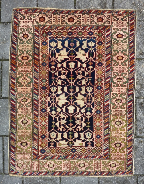 Kuba Konagkend, 130 x 100 cm., dated 1879 (1295). Good pile all over without any wear. Selvedges replaced, endings reknotted for about a half inch and two small repairs ( pictured ),  ...