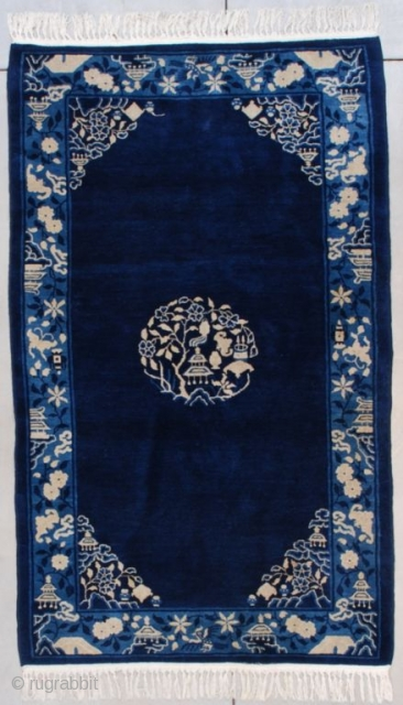 """#7573 Peking Chinese Rug  This circa 1920 Peking Chinese Oriental rug measures 4'1"""" x 6'9"""" (124 x 210 cm). It has a dark blue field with a center medallion composed of a pagoda,  ..."""