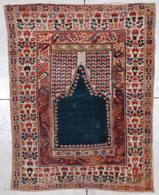 #6952 Ghiordes Antique Turkish Rug 4'2″ X 5'4″This late 17th century to early 18th century Ghiordes measures 4'2″ x 5'4″.