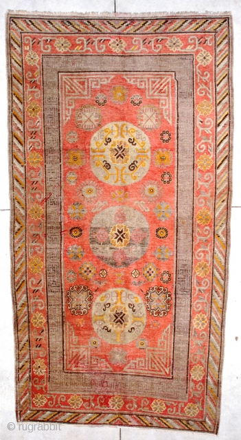 """#6724 Antique Khotan Rug This Circa 1880 Khotan/ Yarkand measures 4'9"""" x 9'0"""". It has a fantastic bittersweet field with three round medallions in very pale green and aubergine with touches of yellow  ..."""