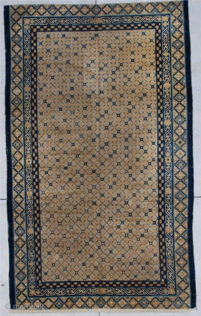 """#6882 Very Antique Kansu Chinese Rug  This circa 1800 or earlier  Chinese rug measures 5'7"""" x 9'2"""". It has a yellow ground with the crosshatch design in a flower motif.   ..."""