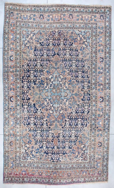 """#6942 Antique Khorassan Persian Rug This circa 1880 Antique Khorassan Persian Oriental Carpet measures 10'1"""" X 17'3"""". It has a large lobed pulled medallion with a sky blue center surrounded by peach, filled  ..."""