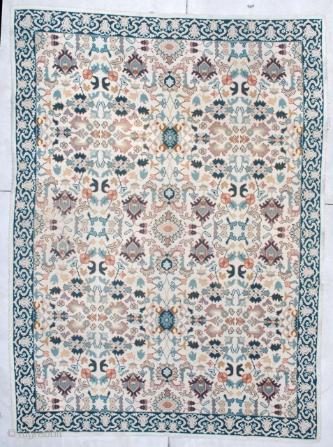 "This semi-antique Portuguese Chain Stitch rug measures 8'0"" x 11'0"". It has an overall design with palmettes in blue, green, and rust with vines and flowers on an ivory ground.  The  ..."