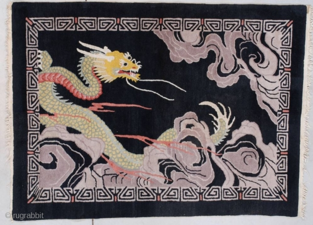 """#7702 Art Deco Chinese Rug  This circa 1920 Chinese Oriental rug measures 3'0"""" X 5'1"""" (91 x 182 cm). It has a multicolored dragon in green, gold, ivory, red and teal winding through  ..."""