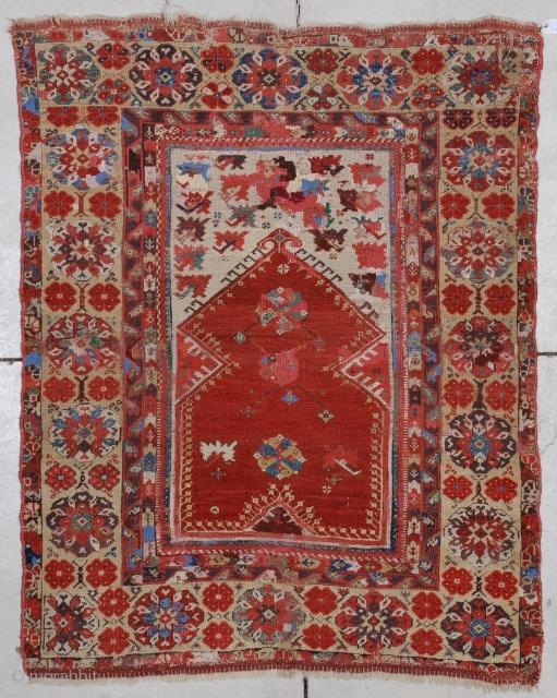 "#7177 Melas Antique Turkish Rug This circa 1825 Melas or Melez antique Oriental carpet measures 3'8"" X 4'10""(115 x 152 cm). It has a tomato red prayer niche on an ivory ground with  ..."