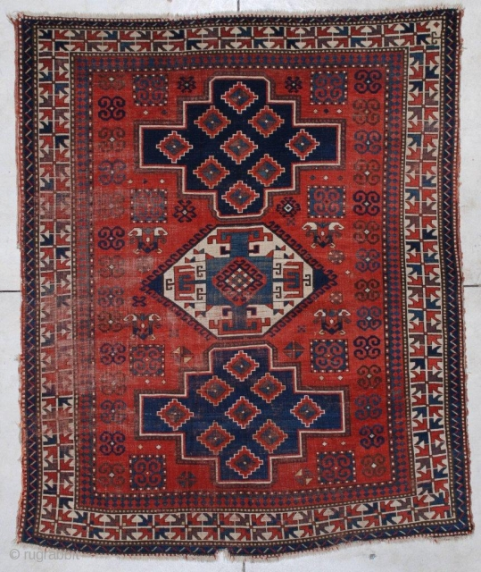 "#7173 Kazak Antique Caucasian Rug  This late 19th century Lori Pambeck Kazak antique Oriental rug measures 6'4"" x 7'9"". It has three medallions in medium blue, dark blue and ivory with a  ..."