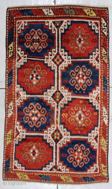 """#7283 Kazak Antique Caucasian Rug  This circa 1875 Caucasian Kazak rug measures 3'9"""" X 6'6"""". It has the Mogan motif in red and blue with ivory negative spaces. It has one narrow  ..."""