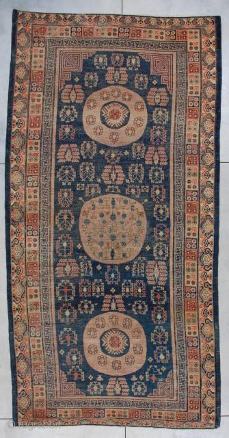 "#7285 Antique Khotan Oriental Rug 6'8″ X 13'1″ This  Khotan antique Oriental Carpet measures 6'8"" x 13'1"" (207 x 399 cm). It has three aubergine dyed medallions. The two end medallions have  ..."