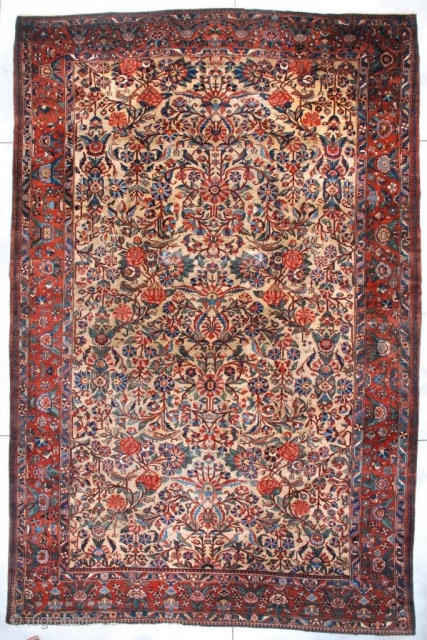 """#7336 Bibicabot Antique Persian Rug 11'0″ X 17'0″ This circa 1920 antique Persian Bibicabot Oriental Rug measures 11'0"""" X 17'0"""" (335 X 517 cm). The ground is woven in an old ivory color  ..."""