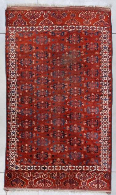 "#7373 Antique Yomud Bohkara Rug  This circa 1890 Yomud Bohkara measures 6'2"" x 10'7"" ( 188 x 326 cm). It has a mahogany colored field covered in Kepsi guls in various shades  ..."