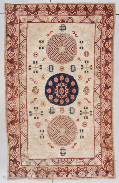 """#7509 Antique Khotan Rug This Khotan Oriental rug measures 5'0"""" x 8'1"""" (152 x 246 cm). It has a pale camel field containing three medallions. The corners are worked in a modified Greek  ..."""