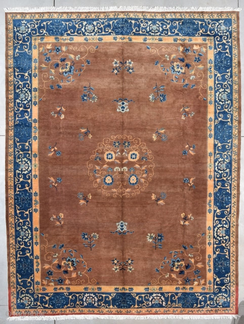 "This last quarter 19th century Peking Chinese Oriental Rug measures 10'1 X 13'6"" (308 x 515 cm). It has a medium brown field ala milk chocolate and a medallion with four flowers  ..."