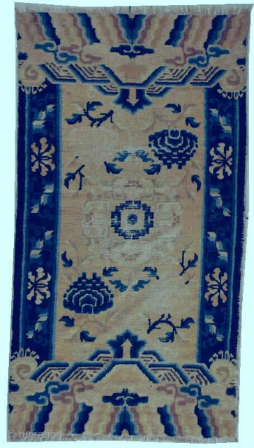 """#5935 Ningxia  This circa 1800 Ningxia measures 2'11"""" X 5'2"""". It has a center medallion in ivory with a blue center with either blue or pink chrysanthemums in the corners of the field.  ..."""