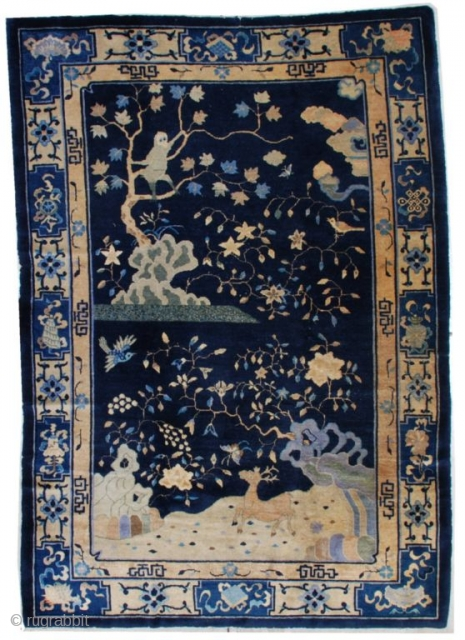"""#7184 Peking Chinese Rug  This circa 1910 Peking Chinese Oriental rug measures 6'1"""" X 8'10"""". It has a navy blue ground with a single motif.  There is a large silver gray monkey  ..."""