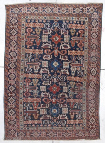 "http://www.antiqueorientalrugs.com/CLOSEUP%20PAGES/7240%20kuba.htm This third-quarter 19th-century Prepedil Kuba measures 3'5' X 4'11"". It has a dark blue ground with ram's horn motif.  There are four nice stars running up the center in red  ..."