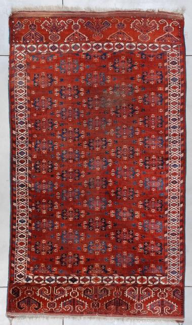 "#7373 Yomud Bohkara  This circa 1890 Yomud Bohkara measures 6'2"" x 10'7"" ( 188 x 326 cm). It has a mahogany colored field covered in Kepsi guls in various shades of blue encompassed  ..."