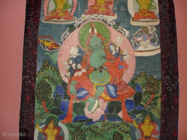 Tibetan tanghka http://www.antiqueorientalrugs.com/Thangkas/4534closeup.htm