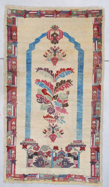 """#7520 Ghordez Rug  This circa 1850 Ghordez measures 3'6"""" X 6'3"""" (109 x 192 cm). This extremely interesting Ghordez is woven in a coupled column motif with a tree of life motif growing  ..."""
