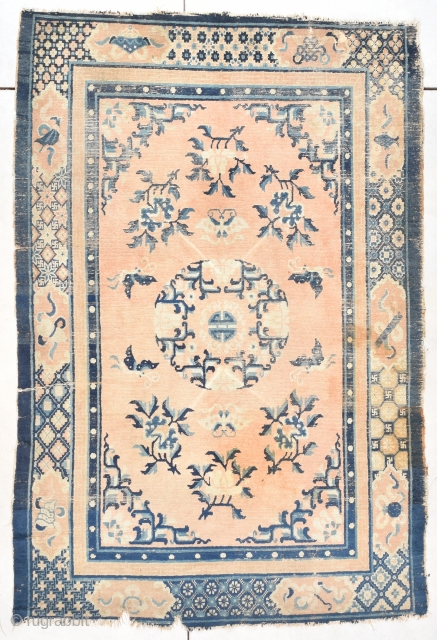 #7768 Ningxia Rug  This Ningxia rug has a peach field consisting of a center wreath with a Shou symbol in the middle. There are floral sprays in the field of the rug and  ...