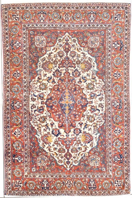 "This 1st quarter 20th century antique Isfahan Persian Oriental rug #7751/7752 measures 4'9 "" x 7'3"". It is one of a matching pair of rugs. It has an ivory floral medallion with  ..."