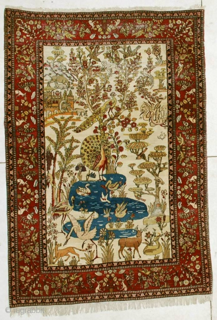 """#6450 Laver Kerman antique Rug  This Laver Kerman measures 4'6"""" X 6'5"""". It has a hunting scene and a tree of life design on an ivory ground. The rug has a lively design  ..."""