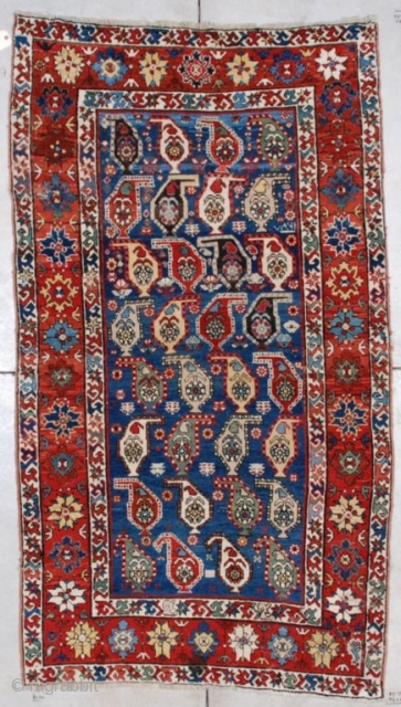 """#7055 Kazak  This Kazak measures 4'2"""" X 7'5"""". It is dated 1870 and there is no reason in the world to doubt it. The central motif are botehs in rows of four facing  ..."""