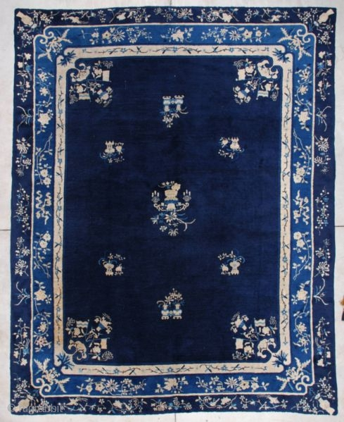 """http://www.antiqueorientalrugs.com/CLOSEUP%20PAGES/7205%20Peking%20Chinese%20Rug.htm This circa 1890 Peking Chinese Oriental Rug measures 9'2' X 11'9"""". It has a navy blue field with an urn of flowers in white and pale blue and two hanging tasseled  ..."""