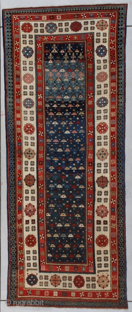 """http://www.antiqueorientalrugs.com/CLOSEUP%20PAGES/7188%20talish%20rug.htm This circa 1880 antique Talish measures 3'5"""" X 8'10'. It has a blue field with a multicolored triangle motif.  It has an ivory main border with the carnation and dice  ..."""