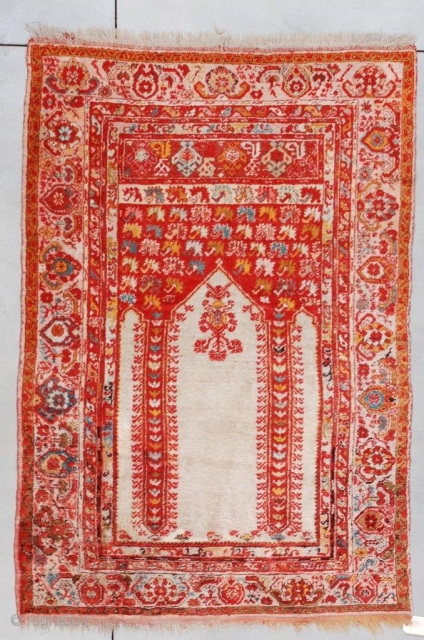 "#7259 Angora Kula Antique Turkish Rug  This last quarter 19th century antique Angora wool Kula Oriental carpet measures 4'4"" X 6'3"" (135 X 192 cm). It is a coupled column prayer rug with  ..."